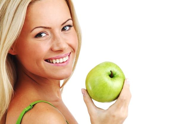 여자 먹는 녹색 사과