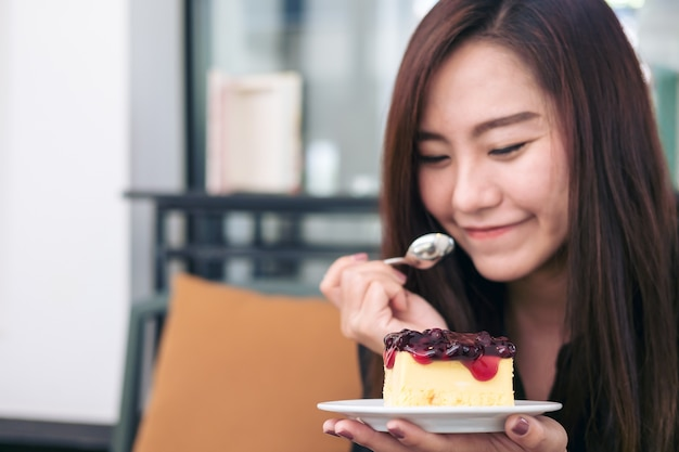 Woman eating blueberry cheese cake