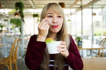 Woman eating melon ice-cream happiness