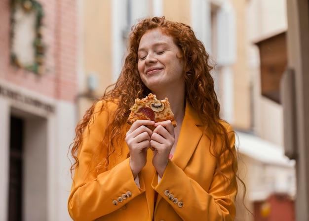Woman eating street food outdoors