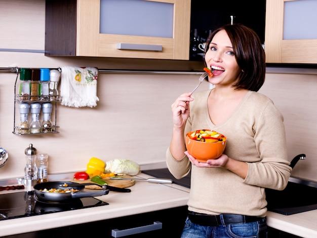 Woman eats the fresh vegetables