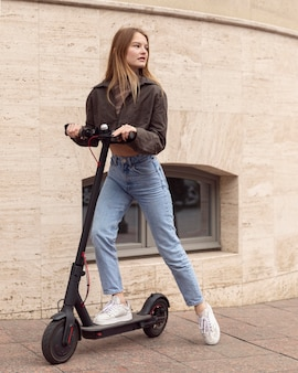 Woman on electric scooter outdoors