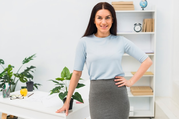 Woman in elegant clothes standing in office