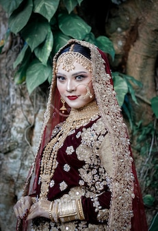 Woman in elegant jewelry and indian typicla clothes portrait