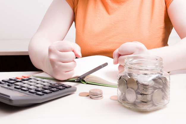 Woman emotionally clenched her fists, counting finances