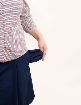 Woman empty pockets isolated white background hand black