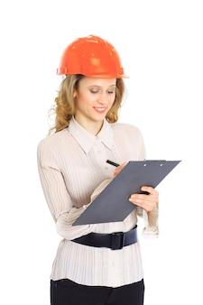 A woman engineer in helmet.