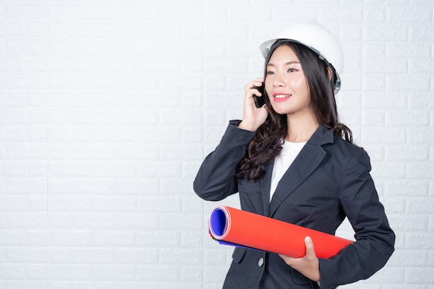 Woman of engineering holding documents