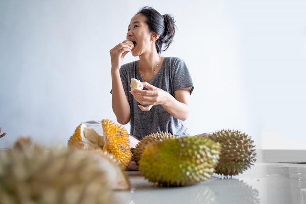 Woman enjoy eating durian fruit