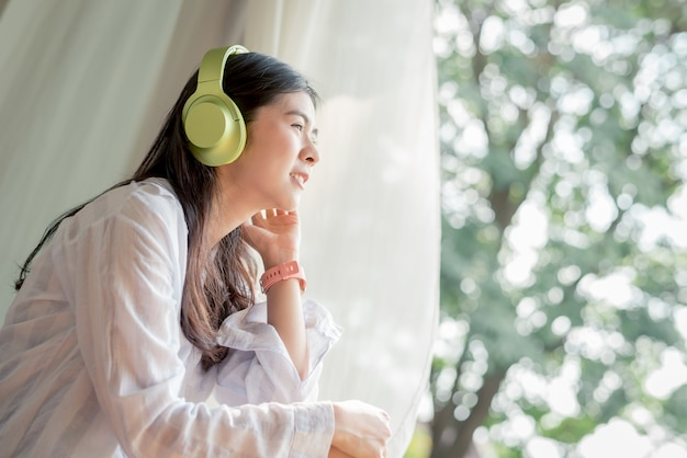 Woman enjoy free time and listening to the music
