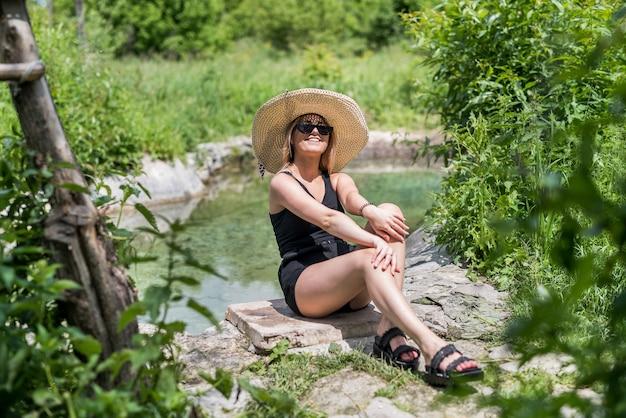 Woman enjoy spending time near lake. summer