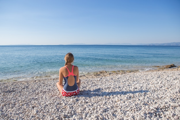 Woman enjoy tropical vacation. resting relaxing on the  beach near sea. greece