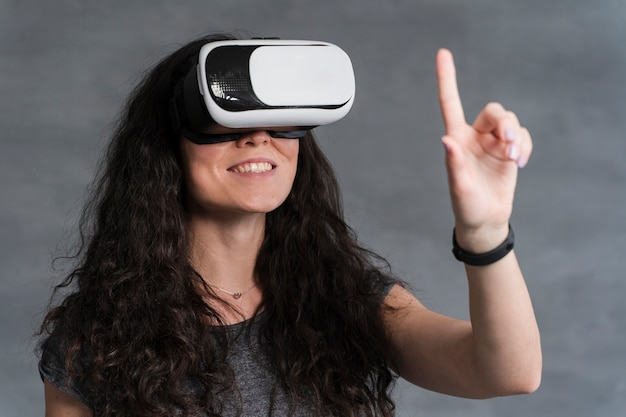 Woman enjoy using the vr and holding a hand up