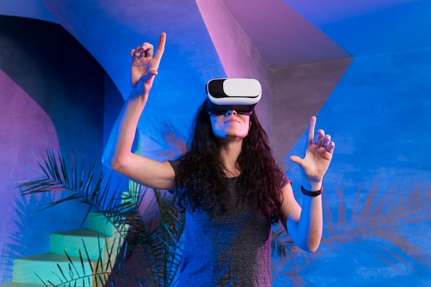 Woman enjoy using the vr indoors