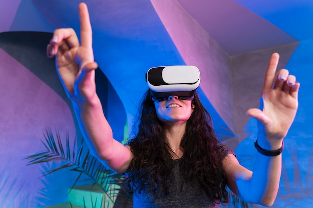 Woman enjoy using the vr and pointing with fingers