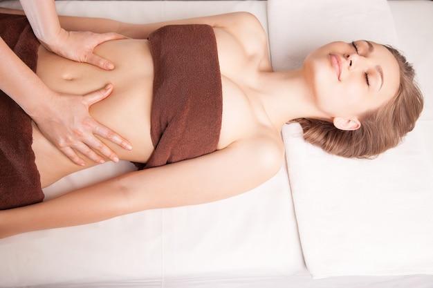 Woman enjoying a ayurveda oil massage treatment in spa