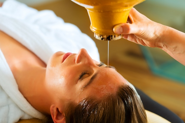 Woman enjoying a ayurveda oil massage