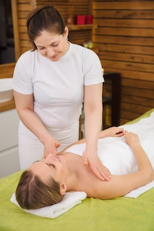 Woman enjoying classical neck and shoulder massage