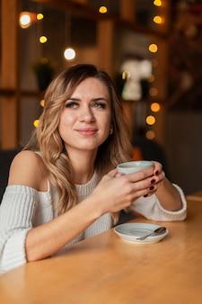 Woman enjoying cup of coffee