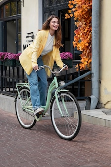 Woman enjoying cycling in the city