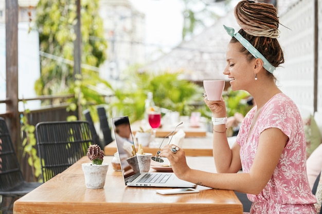 Woman enjoying dessert and drink in cafe