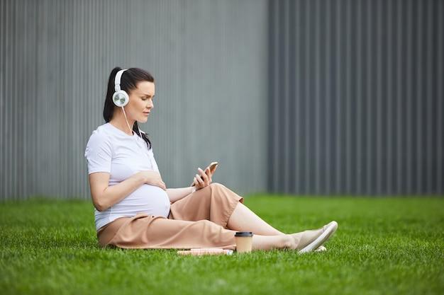 Woman enjoying the music on the grass