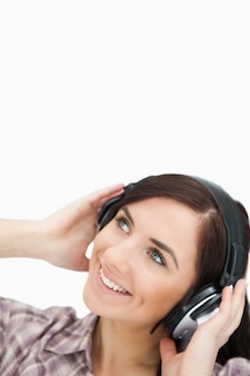 Woman enjoying music with headphones while looking up