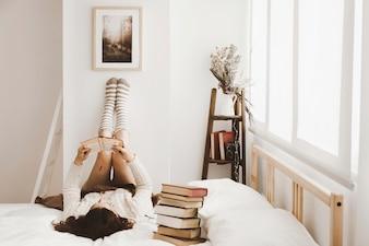 Woman enjoying reading in stylish room