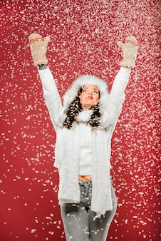 Woman enjoying the snow while wearing winter clothes