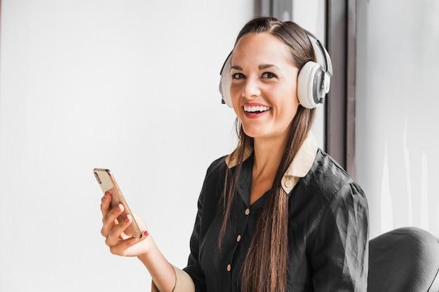 Woman enjoying some music at work