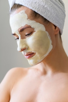 Woman enjoying spa day with face mask