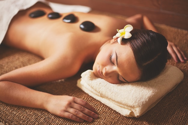 Woman enjoying a stone massage