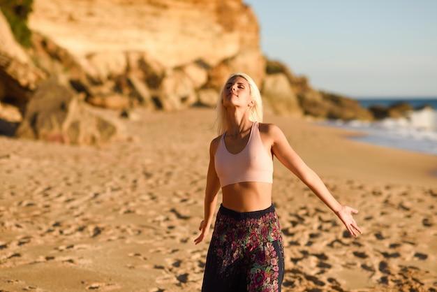 Woman enjoying the sunset on a beautiful beach