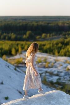 Woman enjoying walk in the mountains in summer