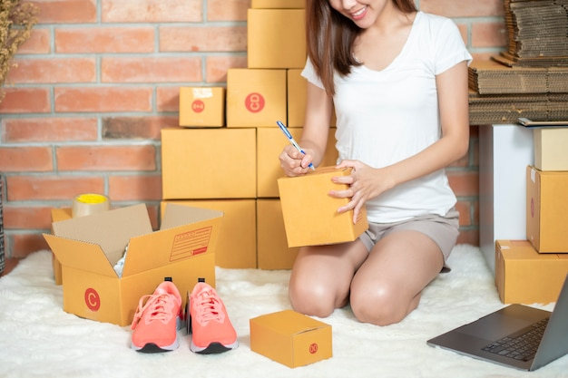 Woman entrepreneur owner sme business is checking order