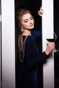 Woman in evening dress on home party
