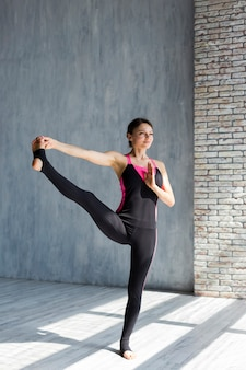 Woman executing a leg extension