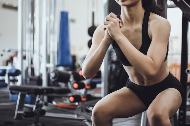 Woman exercise in the fitness gym