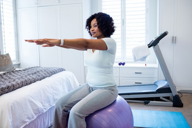 Woman exercising in bedroom
