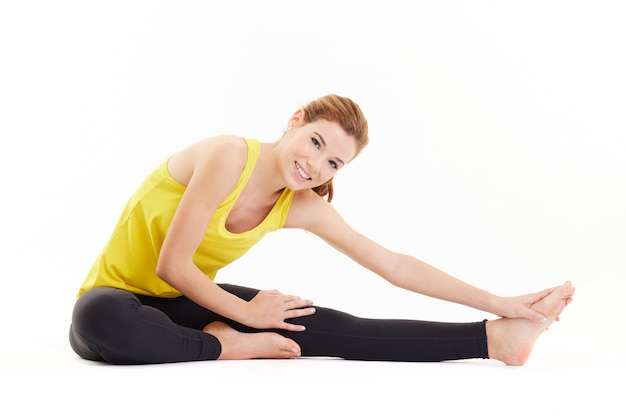 Woman exercising at fitness studio