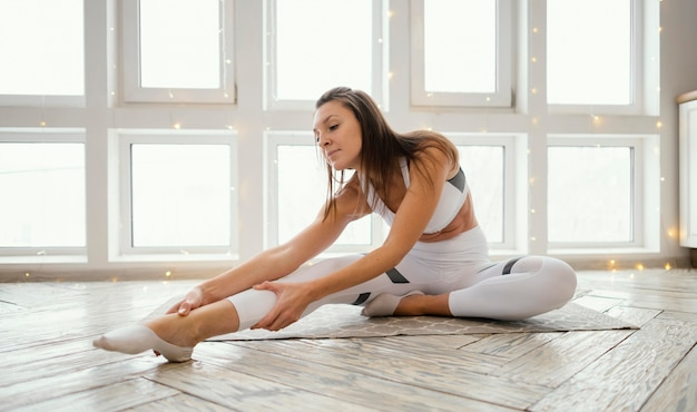 Woman exercising on mat