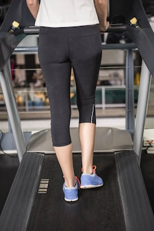 Woman exercising on a treadmill in a gym
