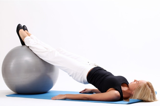 Woman exercising with fitness ball.