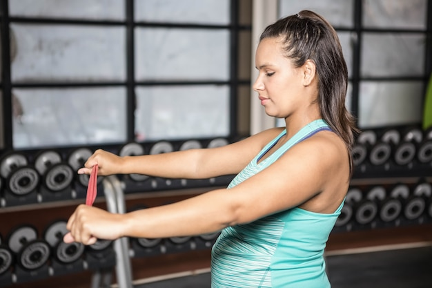 Woman exercising with resistance band in the gym