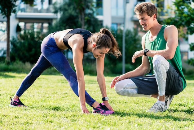 Woman exercising with young man