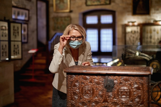Woman exploring medieval expositions in museum