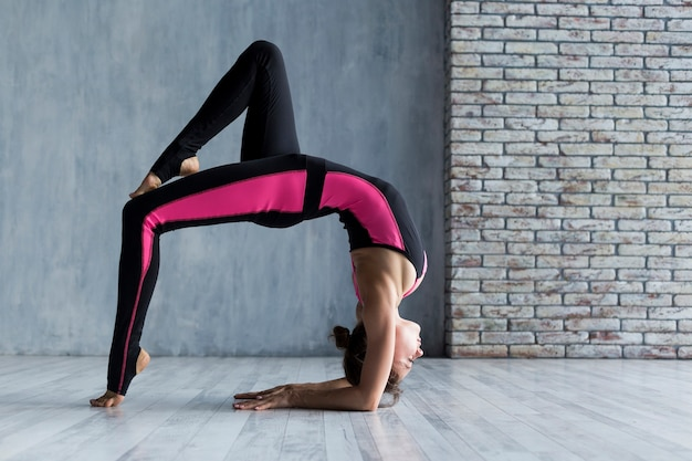Woman extending in a bridge pose