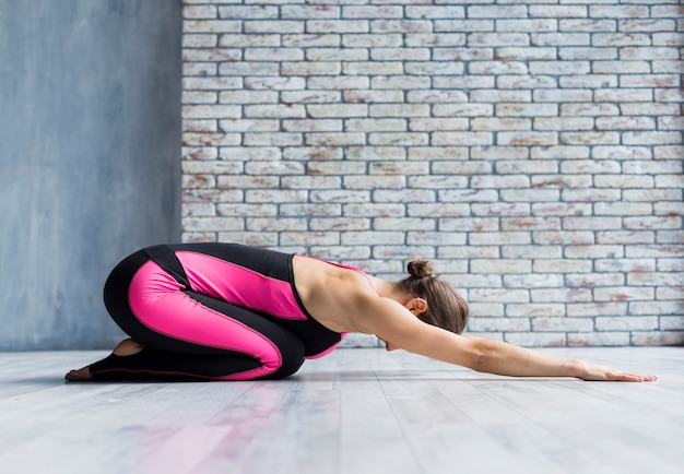 Woman extending her arms forward while doing yoga