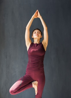 Woman extending her arms above her head