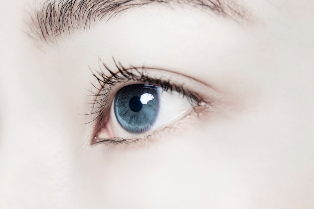 Woman eye with smart contact lens